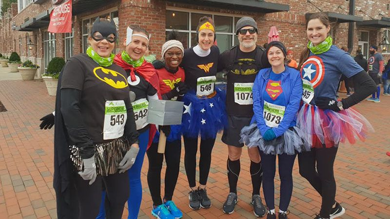 Superheroes and heroines about to run a 5km race in Birmingham