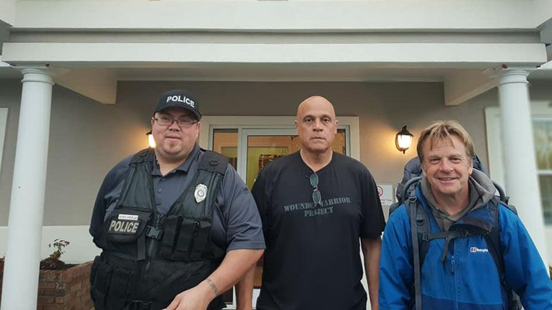 With Chief Randal Beach (the Bruce Willis doppleganger) and Officer Rivera outside Twin City Police Station