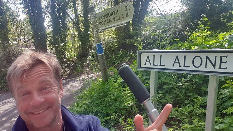The road sign says, 'All Alone'