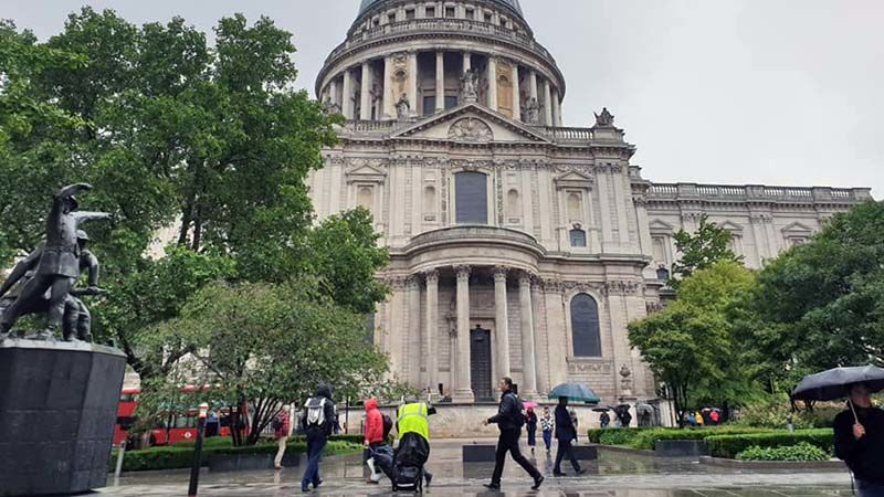 Koko posing outside a splendid but rain drenched St Paul's Cathedral