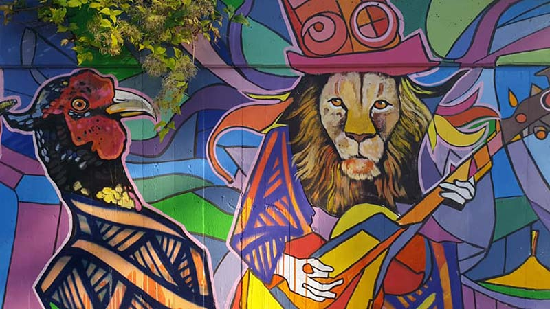 Viennese street art. Got to love a Jimmi Hendrix lion with a pheasant in the mosh pit
