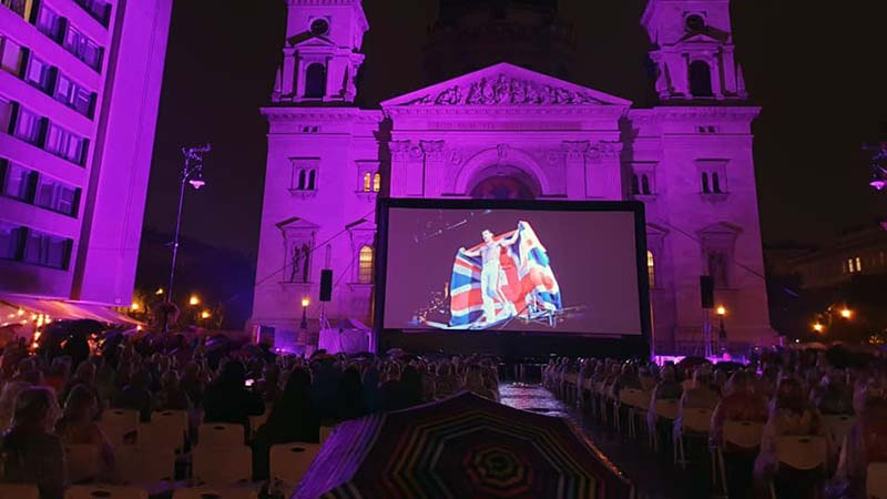 Freddie Mercury singing his heart out at a free open air cinema in front of Budapest's imposing, century old Basilica
