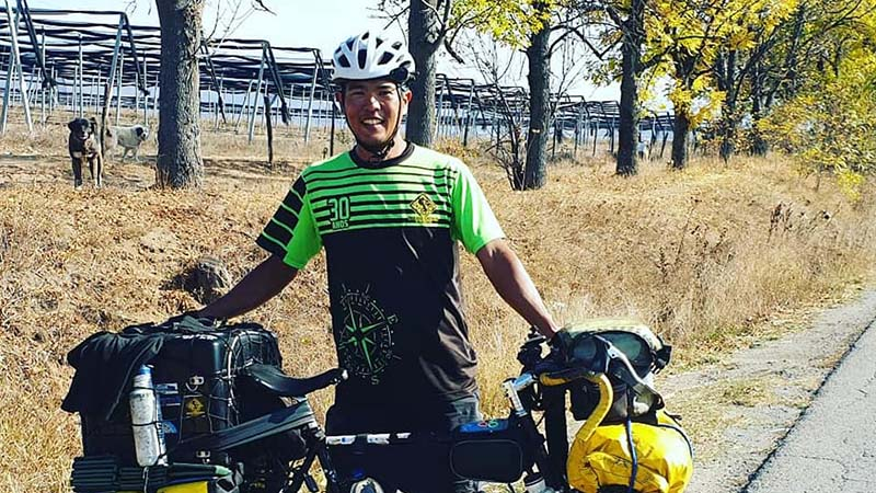 Hamao, a Tiggerish Japanese fireman turned world cyclist, who has covered 100,000 kms over four years