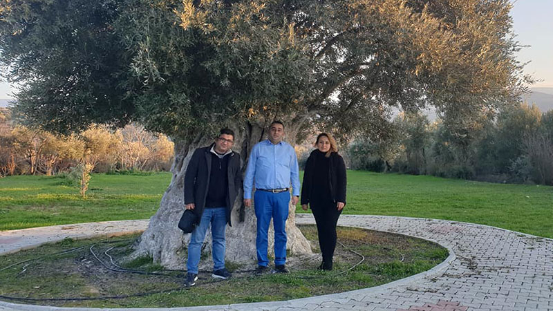 Aydin, Sidika and Murat infront of a 1300 year old olive tree in the Mut valley