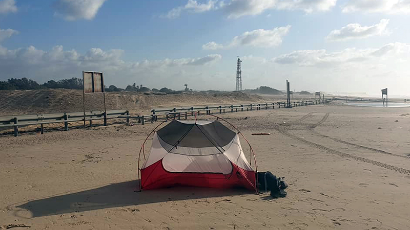 My tent on Zikim Beach, the tower in the distance is on the northern fringe of the Gaza Strip
