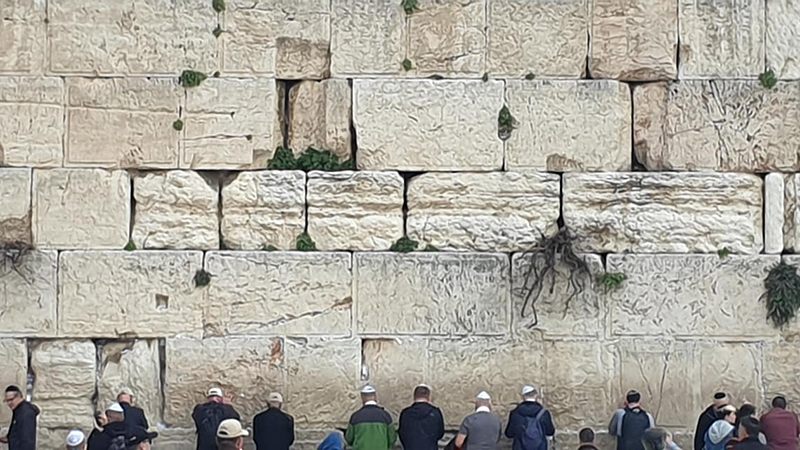The Western Wall, the holiest site for the Jewish people in Jerusalem, from which their world was built on. Prayers written on paper are stuck into the masonry