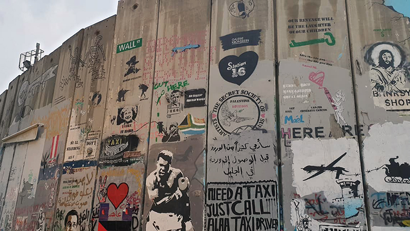 The graffiti strewn wall dividing the West Bank and Israel in Bethlehem